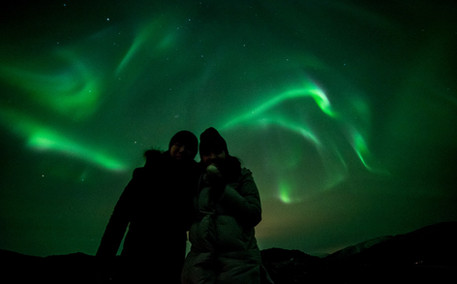 Guests on a northern lights chase near Tromsø, Norway