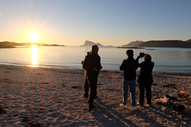 Watching the Midnight Sun on tour with The Green Adventure in Tromsø, Norway. View to Håja Island, near SOmmarøy.