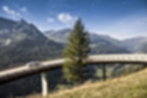car travelling through elevated scenic mountain road