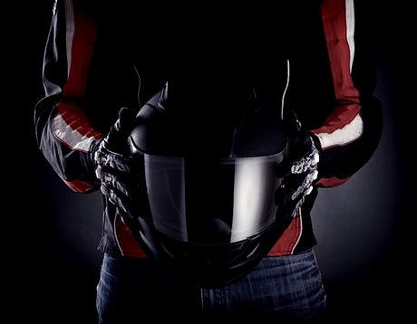 Hands-of-Motorcycle-Rider-Holding-Helmet