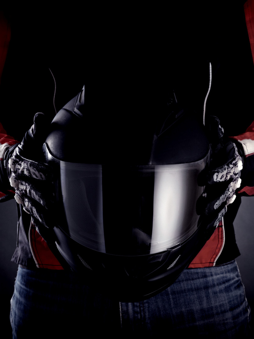 Hands-of-Motorcycle-Rider-Holding-Helmet