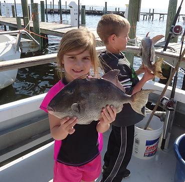 Young girl caught giant trigger fish while fishing on Aqua Venture Charters Charter fishin trip in Pensacola florida