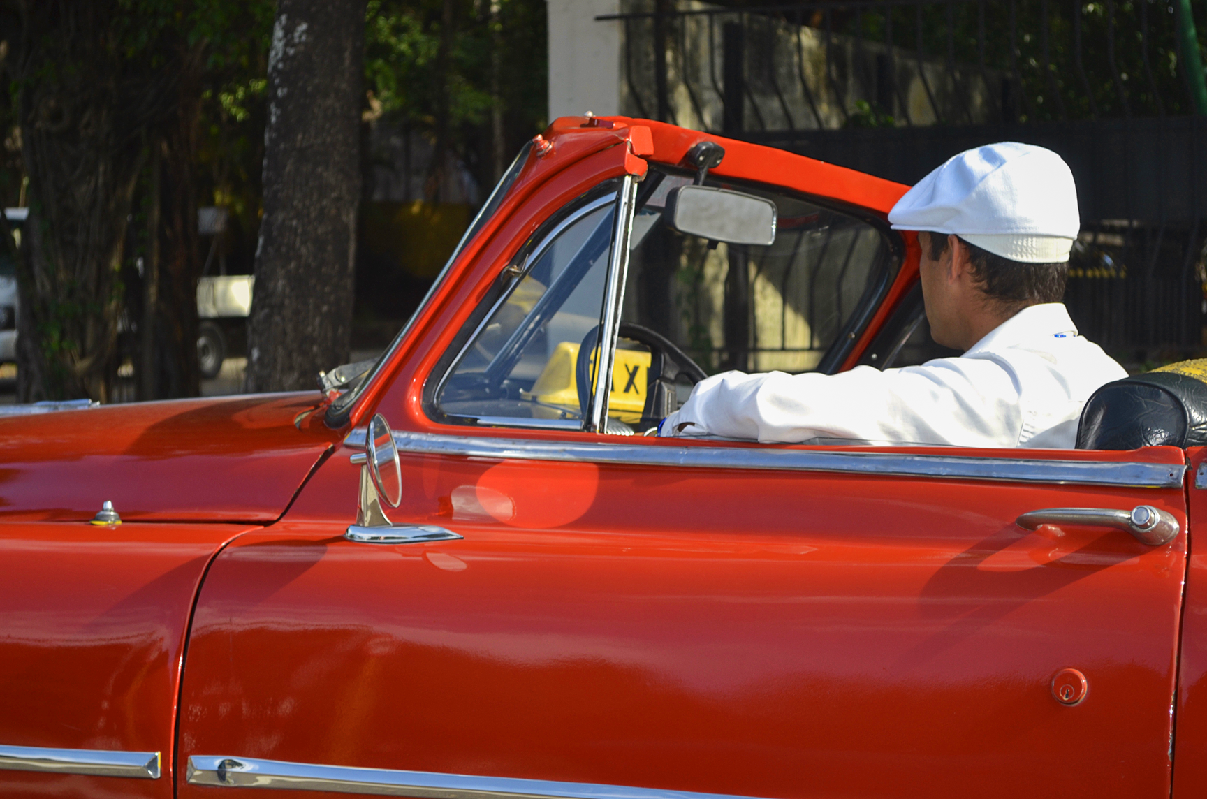 Babalao in Red Convertible