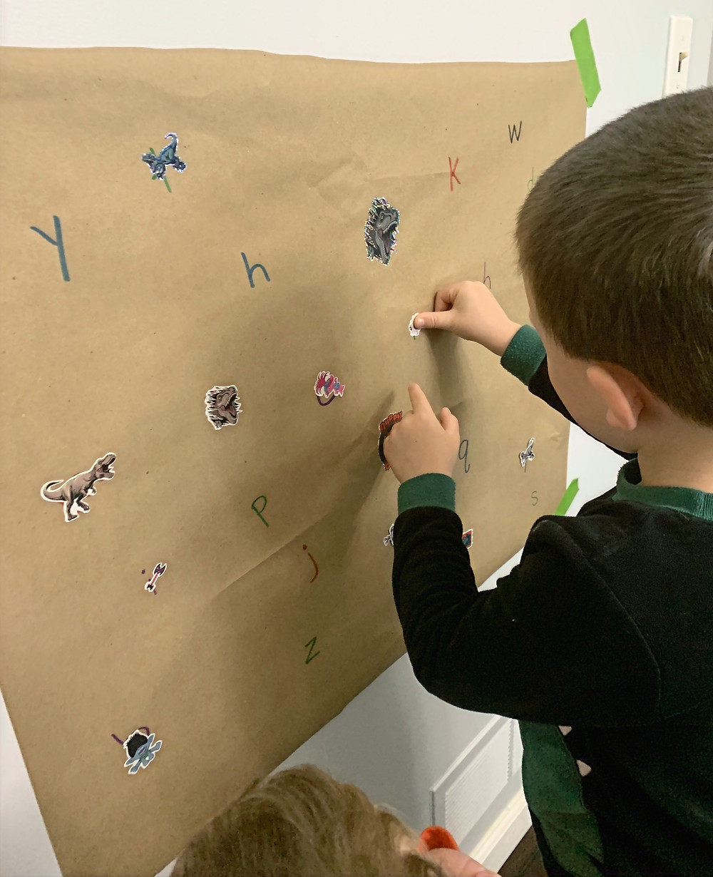 Use stickers to identify letters, numbers, shapes, colors.