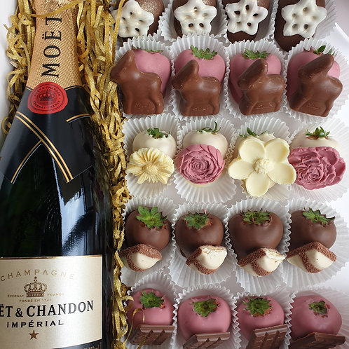 Bottle of Champagne and chocolate strawberries