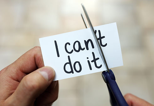 Man using scissors to remove the word can't to read I can do it concept for self belief, positive at