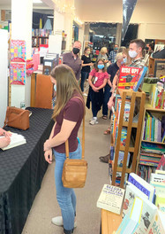 Signing copies of Dark Things I Adore at the launch event on 9/14/2021