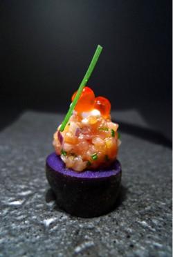 salmon tartare of Purple Peruvian Potato, Lime Cariar and Chive Oil