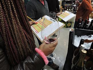 girl holds wine glass at wine sampling tasting event