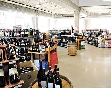 wine bottles and shelves in liquor store