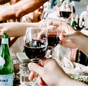 people drinking together red wine