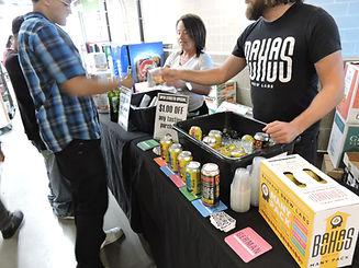 bauhaus employee gives customer sample during beer sampling tasting event