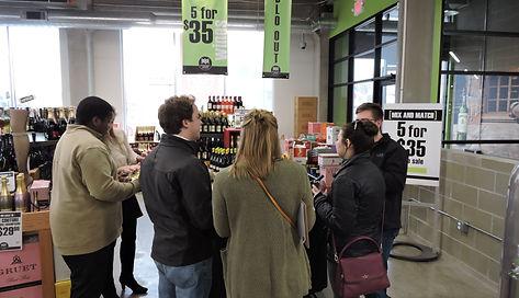 group of people enjoying wine samples