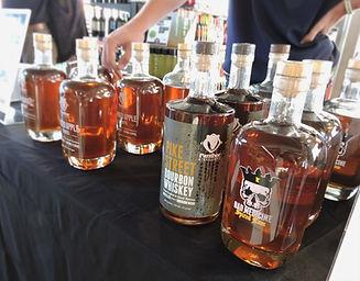 liquor bottles during sampling event rum whiskey bourbons