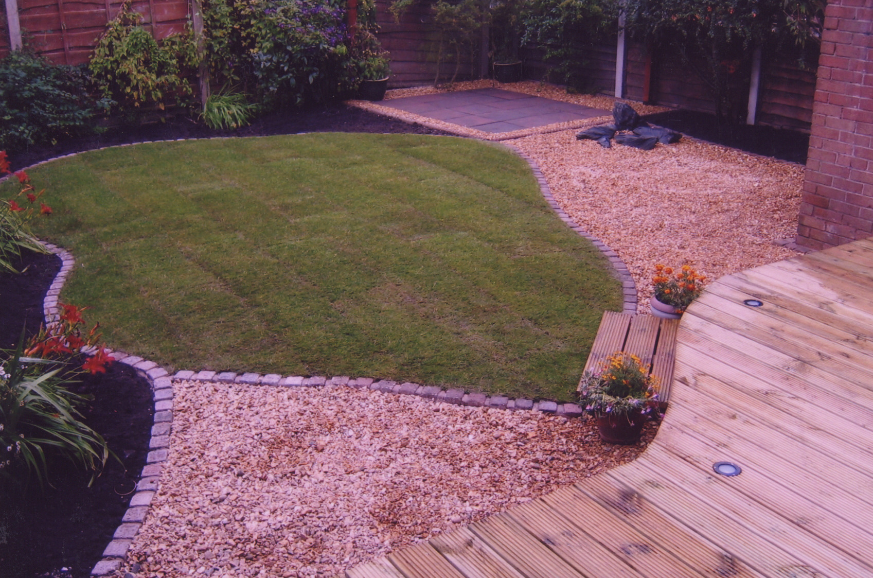 Decking with new lawn edged with set