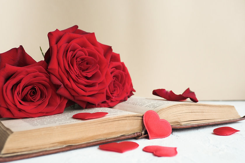 three-red-roses-open-old-book-table-lot-