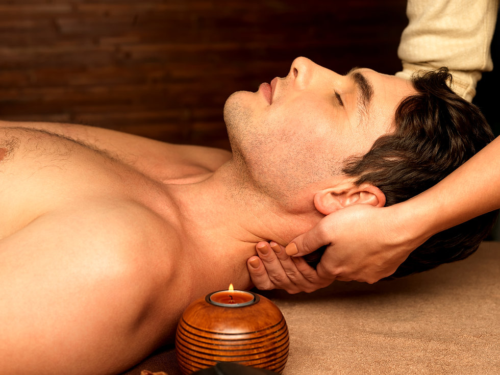 masseur-doing-neck-massage-on-man-in-the