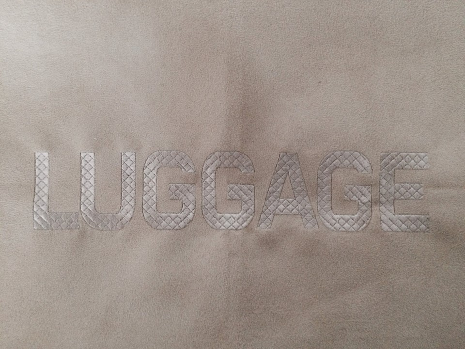 Luggage mat embroidery