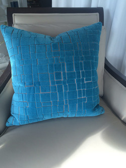 Bright turquoise accent pillow