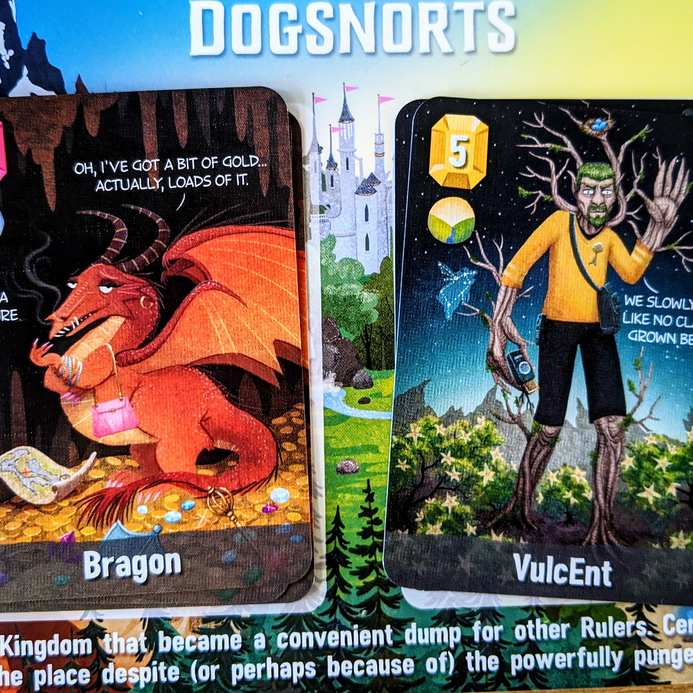 Example of a player board and Bragon and VulcEnt cards from Cover Your Kingdom