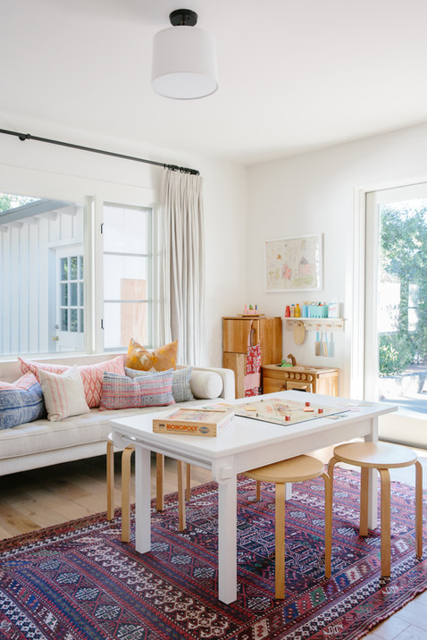 California casual kids playroom, vintage rug, wooden play kitchen by Lilly Walton Design Ojai, Ca
