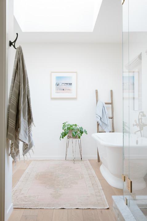 California casual master bathroom, soaking tub, brass fixtures, vintage rug, by Lilly Walton Design in Ojai, Ca