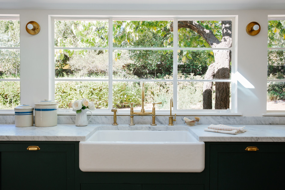 farmhouse sink, dark cabinets and brass fixtures in kithcen designed by Lilly Walton Design Ojai, Ca
