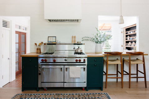 light and airy kitchen with dark cabinets by Lilly Walton Design in Ojai, Ca