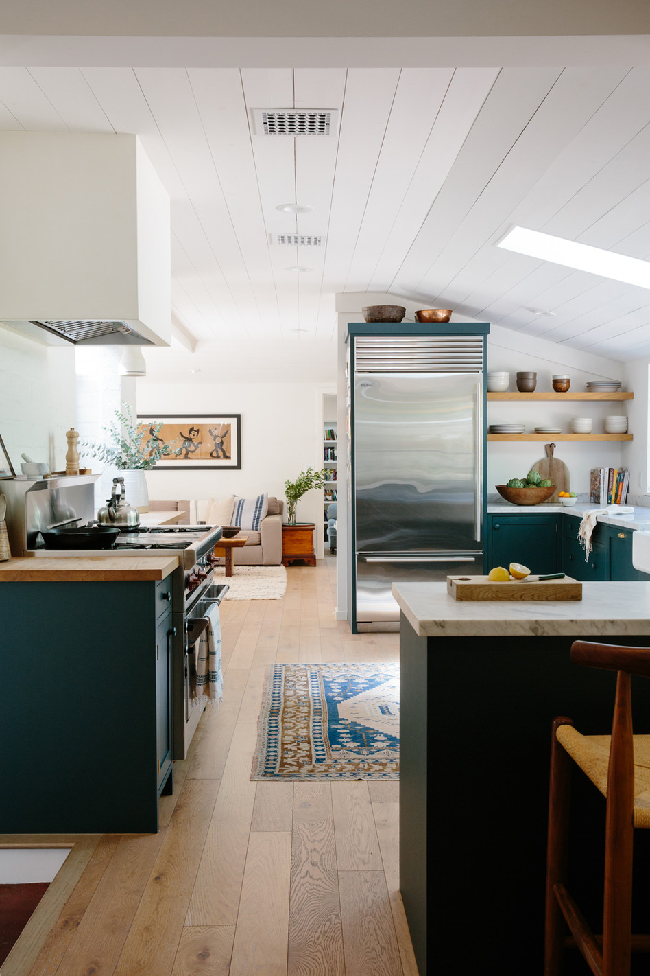 Dark kitchen cabinets in light and bright Ojai, Ca home by Lilly Walton Design