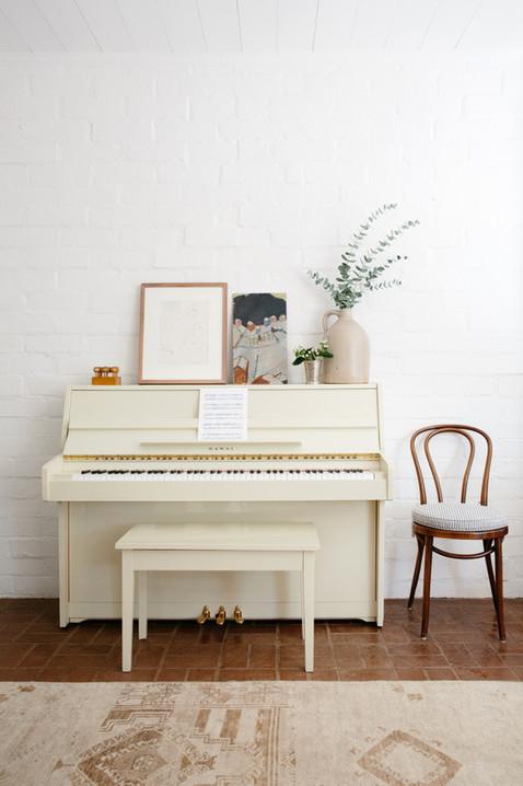 Vintage piano and rug in Ojai, Ca home of interior designer Lilly Walton Design