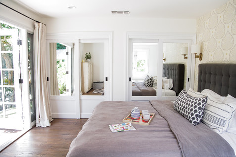 Master bedroom french doors in light and airy remodel by Lilly Walton Design Ojai, Ca
