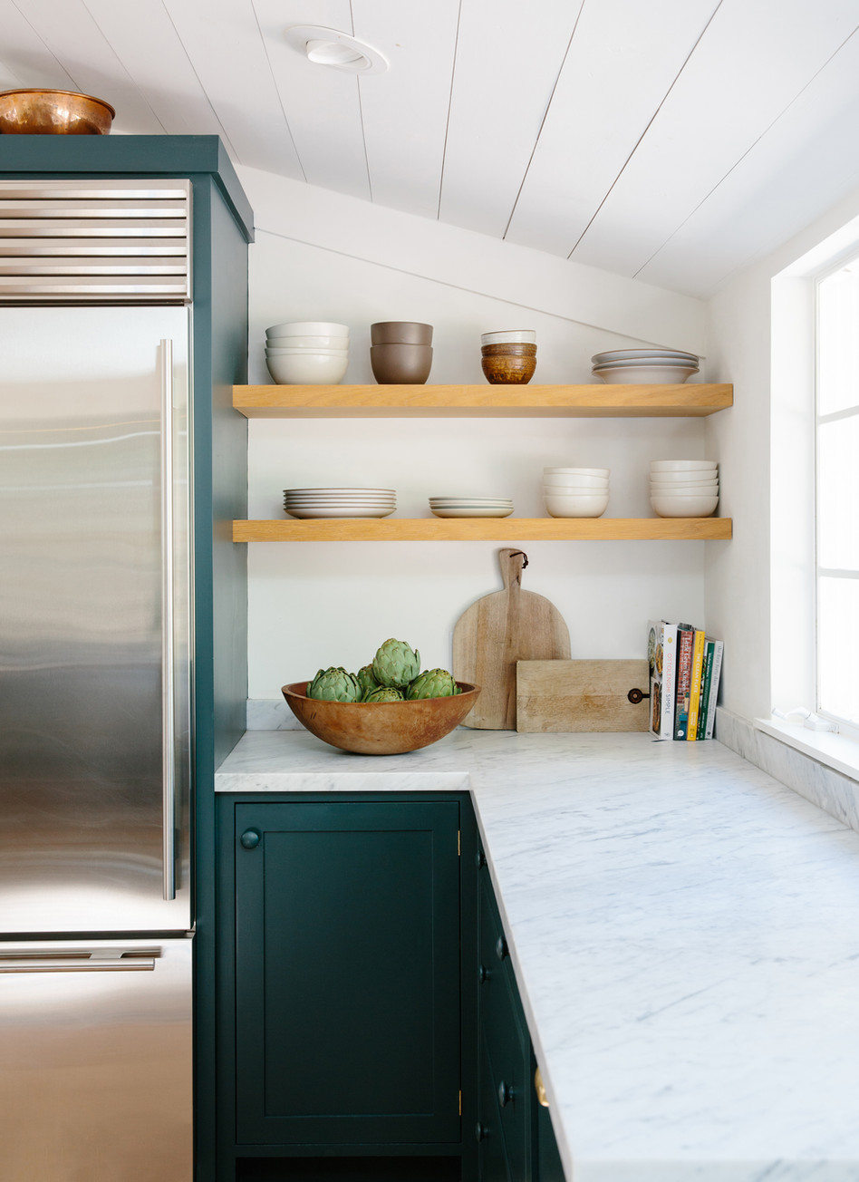 Open shelving, marble countertops, dark cabinets designed by Lilly Walton Design Ojai, Ca