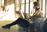 smiling man with laptop.jpg