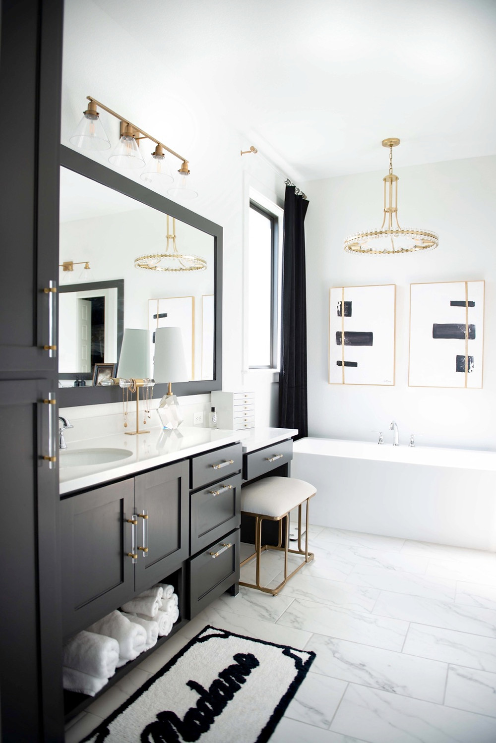 Kendra Scott jewelry box sitting on a luxury bathroom vanity