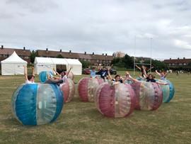 FZY participants in zorbs (bubble balls).