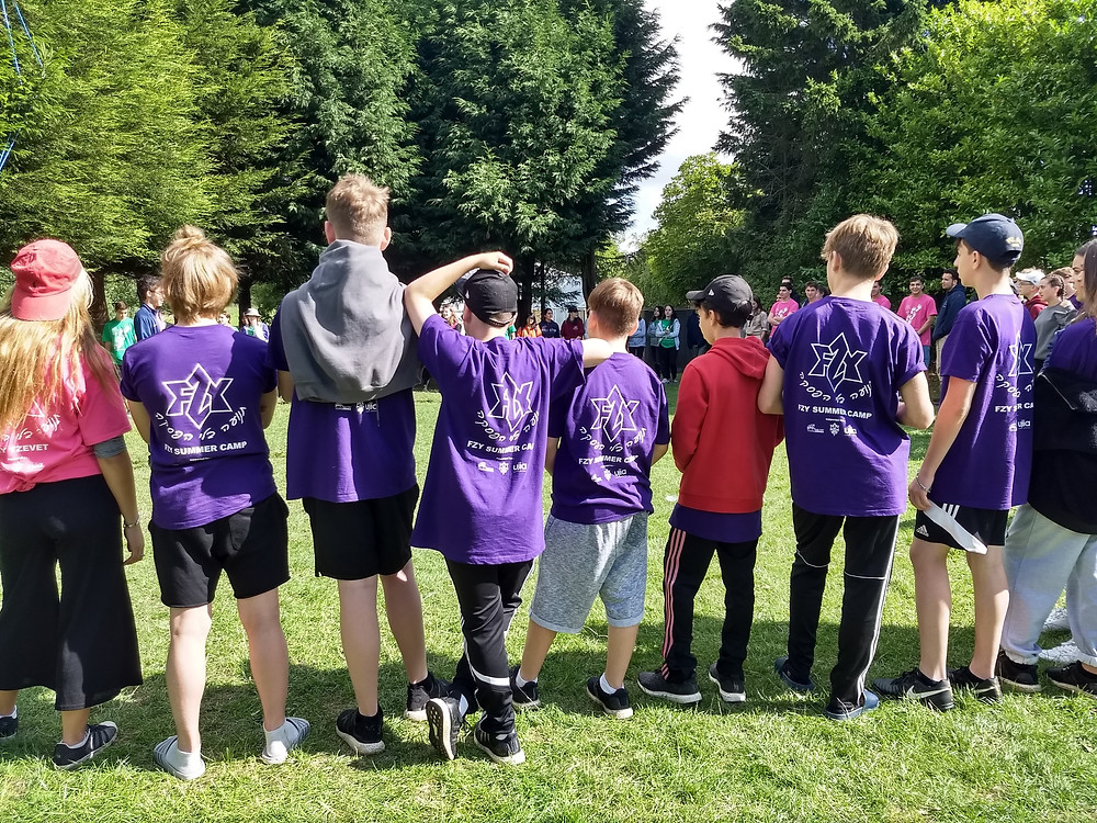 A group of participants in purple FZY T-shirts
