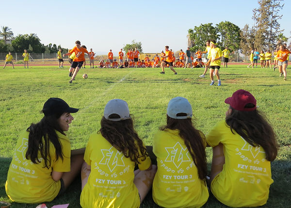 FZY Participantson Israel Tor play football (soccer).