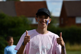 FZY participant in pink gives the thumbs up.