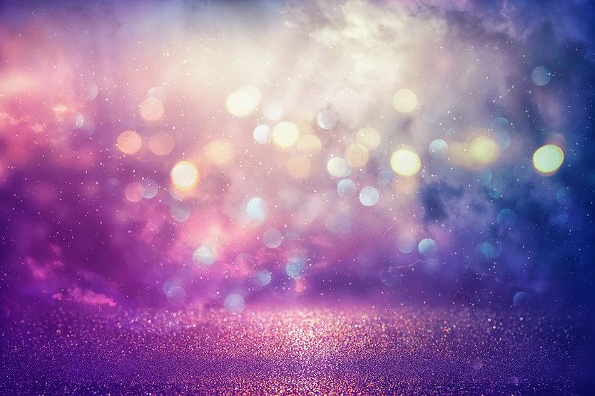 Purple glitter lights background. defocu
