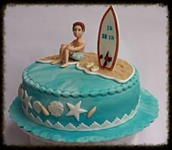 עוגת גולש גלים יושב על החוף