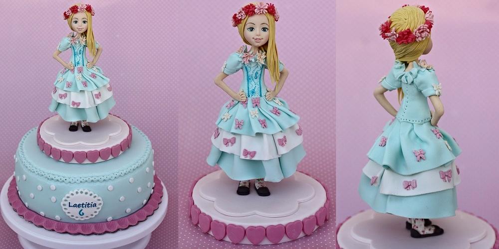 דמות ילדה מפוסלת מבצק סוכר
