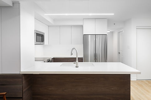 white and brown modern kitchen cabinets