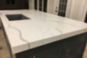 Custom Quartz Countertops - calacatta island installed in Toronto with sink