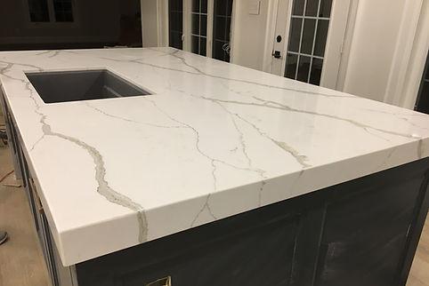 Custom Quartz Countertops - calacatta island installed in Toronto with sink