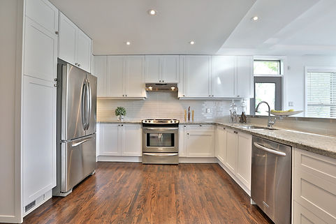 Kitchen Cabinet Refacing - white shaker custom kitchen with brown floor