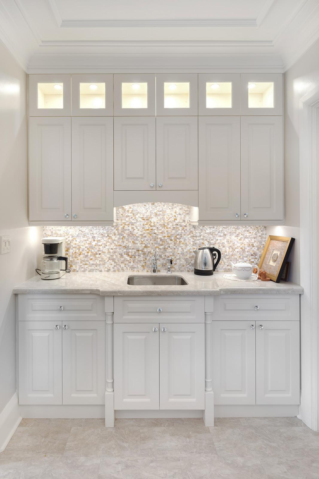 Custom breakfast bar and custom kitchen cabinets