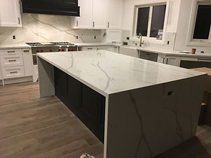 kitchen cabinets Specialists - calacatta quartz countertop that we fabricated in our shop