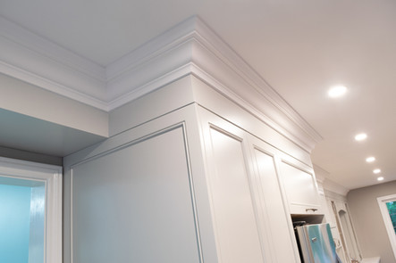 Crown moldings and  custom kitchen cabinets