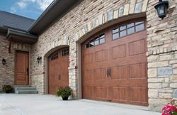 Steel garage door with a wood finish