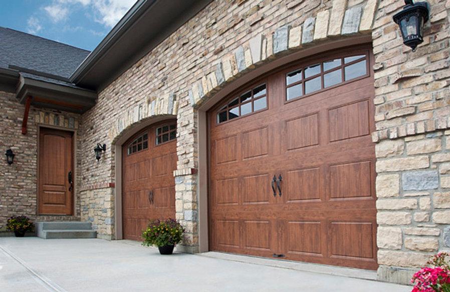 Steel garage door with a wood finish ... & Garage Doors | Joni | Harveyu0027s Garage Door pezcame.com